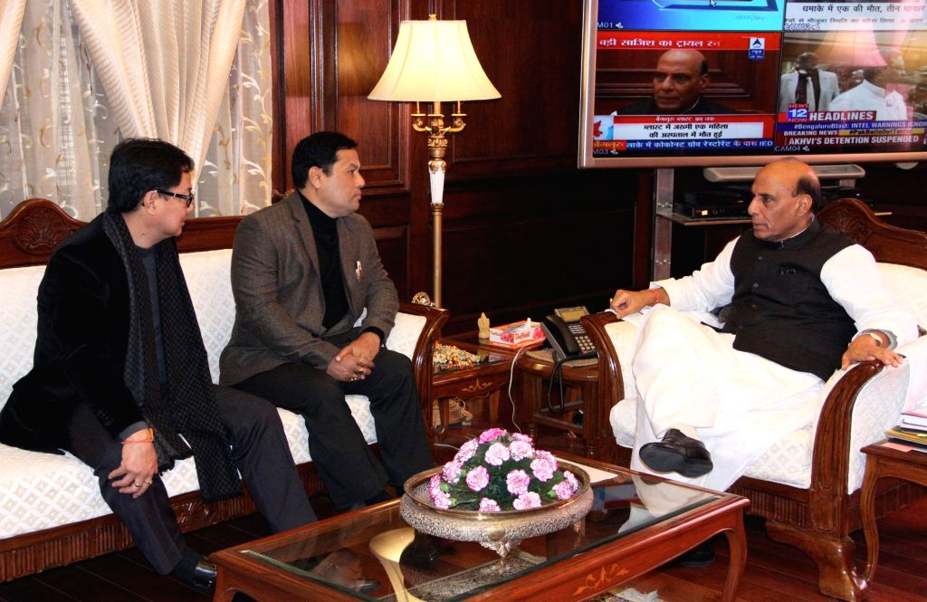Union Home Minister Rajnath Singh during a meeting with the Union Minister of State for Youth Affairs and Sports (Independent Charge), Sarbananda Sonowal and the Union Minister of State ...