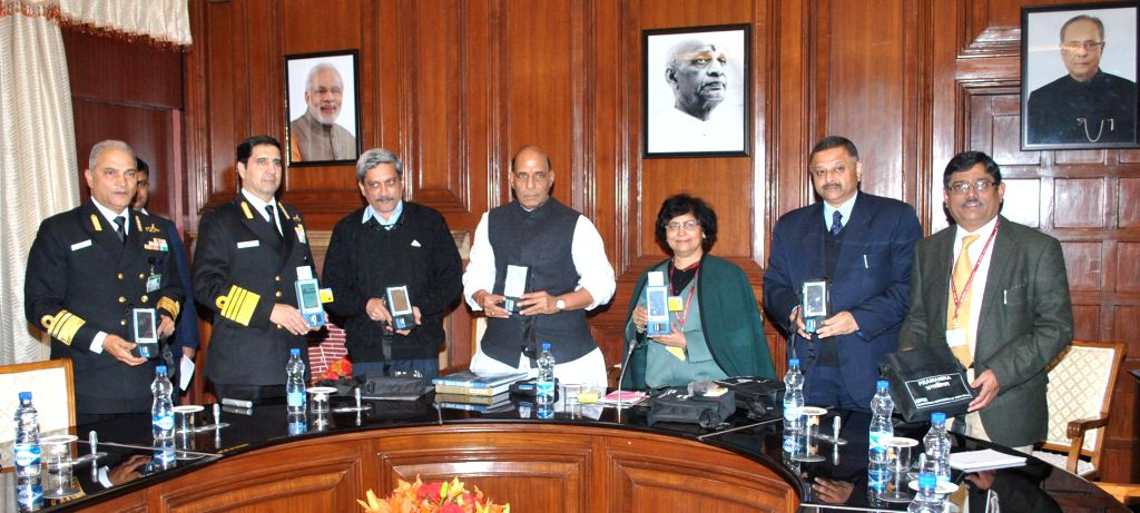 Union Home Minister Rajnath Singh formally handed over Resident Identity Card (RIC) readers, in New Delhi on Jan 14, 2015. Also seen Union Defence Minister Manohar Parrikar, the Chief of .. - Sneh Lata Kumar