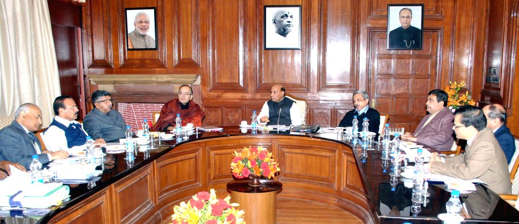 Union Home Minister Rajnath Singh chairs a meeting on the enrollment of Service Voters in Electoral Rolls, in New Delhi on Jan 14, 2015. Also seen the Union Minister for Finance, Corporate - Arun Jaitley and Secretary Ajit Seth
