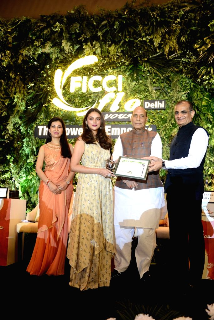 : New Delhi: Union Home Minister Rajnath Singh giving away the Young Women Achievers Awards 2017-18 to actress Aditi Rao Hydari during a function organised by the FICCI in New Delhi on April 6, ...
