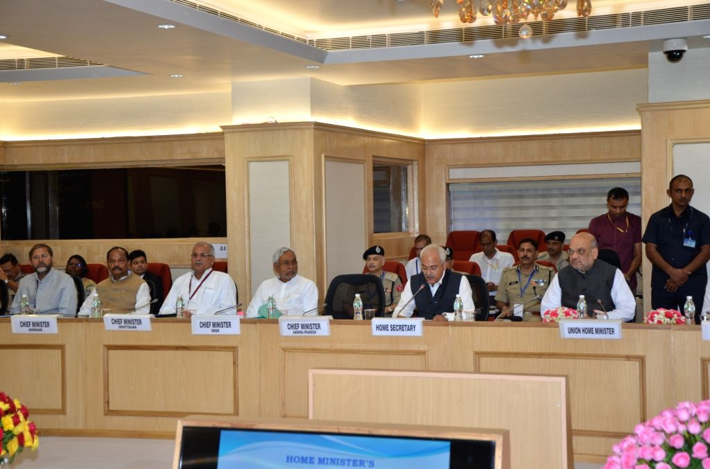 New Delhi: Union Home Ministers Amit Shah chairs hairs a meeting of all Chief Ministers of Maoist-affected states to review the operations against the insurgent groups and initiatives taken over the issue, at Vigyan Bhawan in New Delhi on Aug 26, 201 - Raghubar Das, Amit Shah and Nitish Kumar