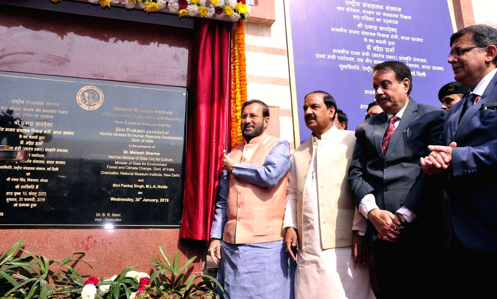 New Delhi: Union Human Resource Development (HRD) Minister Prakash Javadekar and Union MoS Culture and Environment, Forest and Climate Change Mahesh Sharma unveil the plaque to inaugurate ... - Prakash Javadekar and Change Mahesh Sharma