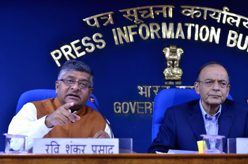 New Delhi: Union Law and Justice Minister Ravi Shankar Prasad along with Union Finance and Corporate Affairs Minister Arun Jaitley addresses a press conference in New Delhi, on March 7, 2019. (Photo: IANS) - Ravi Shankar Prasad and Arun Jaitley