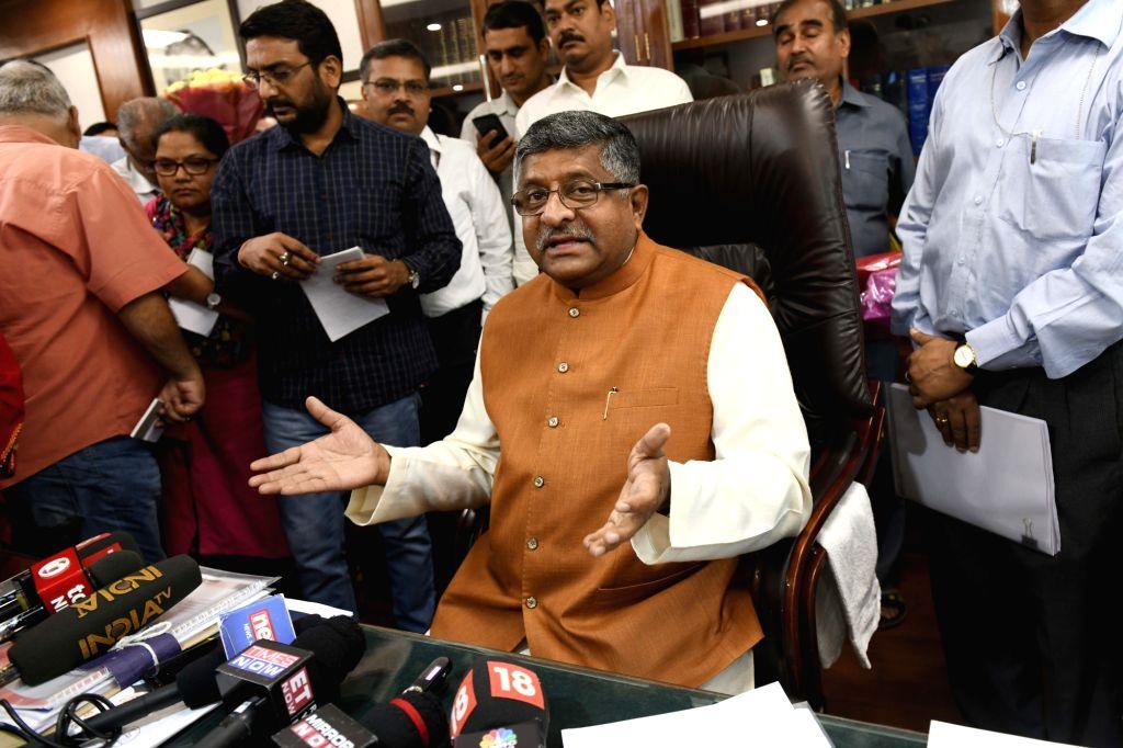 New Delhi: Union Law Minister Ravi Shankar Prasad takes charge in New Delhi on June 3, 2019. (Photo: IANS) - Ravi Shankar Prasad