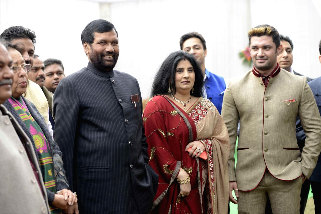 Union Minister for Consumer Affairs, Food and Public Distribution Ramvilas Paswan, LJP MP Chirag Paswan and others during a Sankranti Milan programme organised by the former on Makar ...
