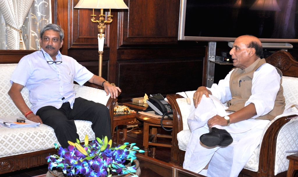 Union Minister for Defence Manohar Parrikar calls on the Union Home Minister Rajnath Singh, in New Delhi on April 13, 2015.