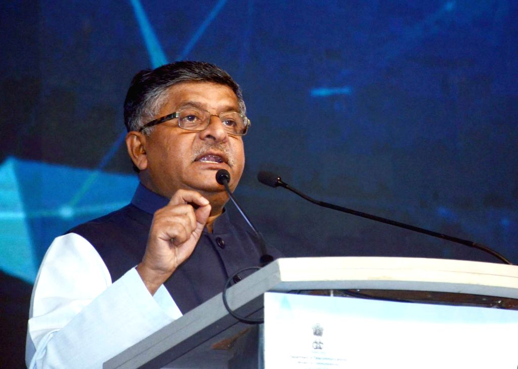 : New Delhi: Union Minister for Electronics and Information Technology and Law and Justice Ravi Shankar Prasad addresses at the India Mobile Congress - 2018, in New Delhi on Oct 25, 2018. (Photo: ...