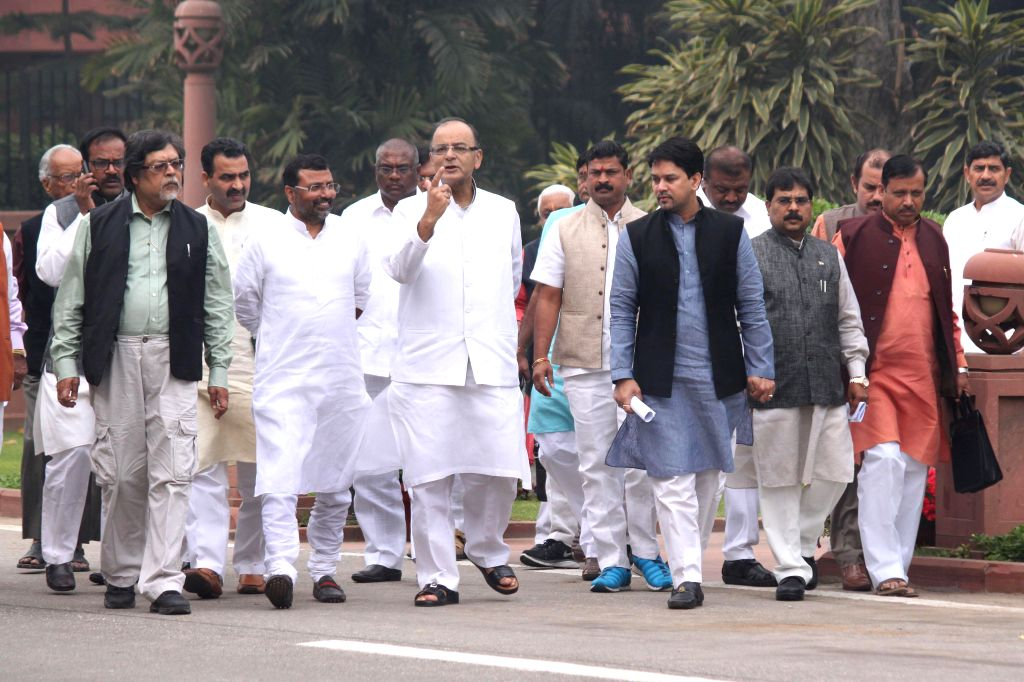 Union Minister for Finance, Corporate Affairs, and Information and Broadcasting Arun Jaitley with other BJP parliamentarians after a BJP parliamentary party meeting on land acquisition ... - Arun Jaitley
