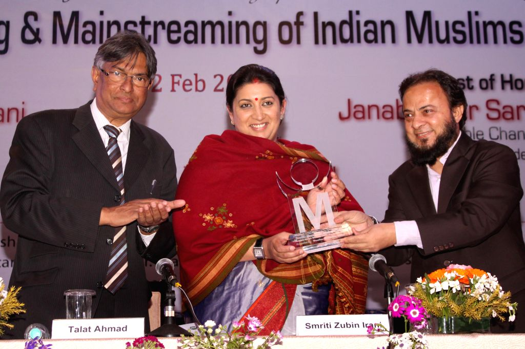 Union Minister for Human Resource Development Smriti Irani, Gujarati businessman Zafar Sareshwala and vice-chancellor of Jamia Milia Islamia Prof. Talat Ahmad during the symposium ...