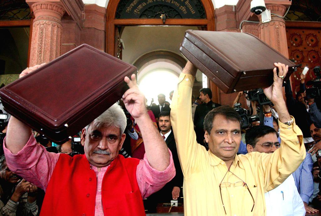 Union Minister for Railways Suresh Prabhakar Prabhu and Union Minister of State for Railways Manoj Sinha arrive at the Parliament to present Railway Budget 2015-16, in New Delhi, on Feb ... - Suresh Prabhakar Prabhu and Manoj Sinha