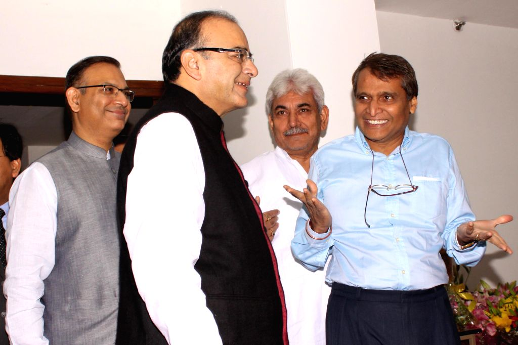 Union Minister for Railways Suresh Prabhakar Prabhu and the Union Minister for Finance, Corporate Affairs, and Information and Broadcasting Arun Jaitley at the signing of a Memorandum of ... - Suresh Prabhakar Prabhu, Arun Jaitley, Manoj Sinha and Jayant Sinha