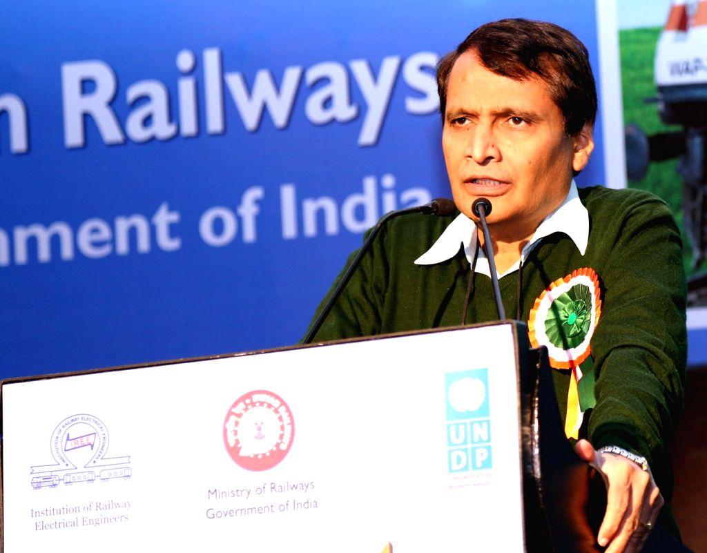:New Delhi: Union Minister for Railways, Suresh Prabhakar Prabhu addresses at the International Summit on Energy Efficient Technologies in Railways, on the theme ``Energy Efficiency Trends and ... - Suresh Prabhu
