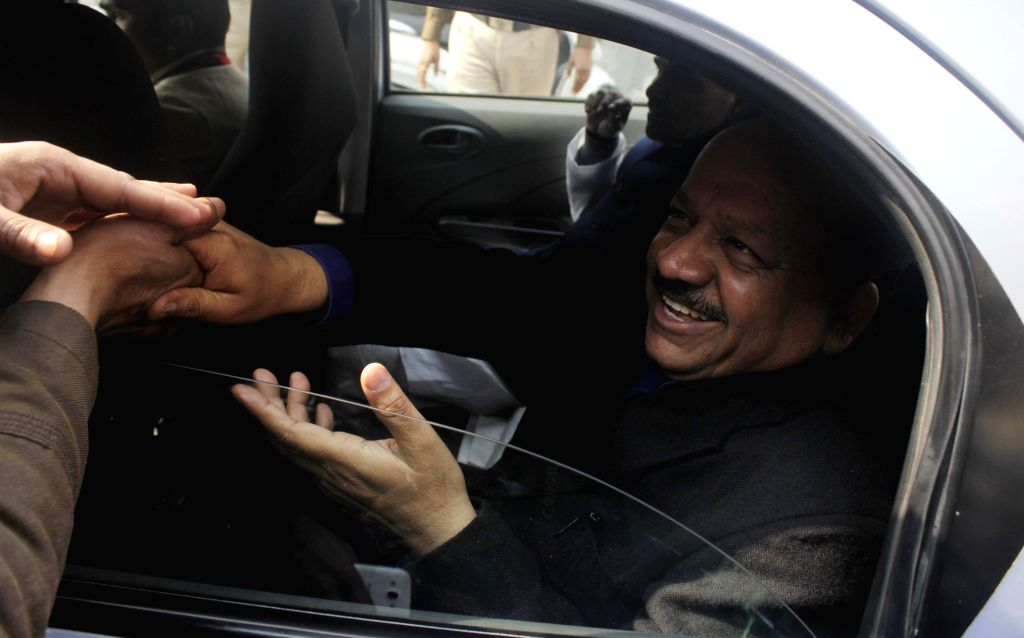 Union Minister for Science & Technology and Earth Sciences Dr. Harsh Vardhan leaves after meeting lawyers in Krishna Nagar of Delhi on Feb 6, 2015.