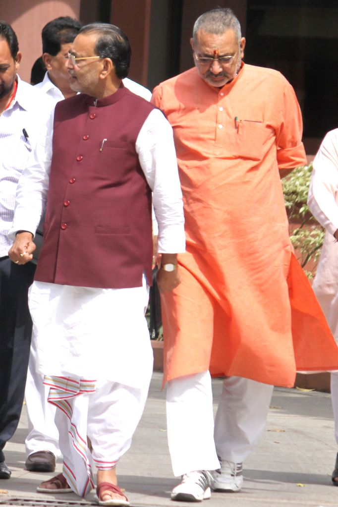 Union Minister for State and Bihar leader Giriraj Singh and Union Agriculture Minister Radha Mohan Singh at the Parliament house in New Delhi on April 21, 2015.