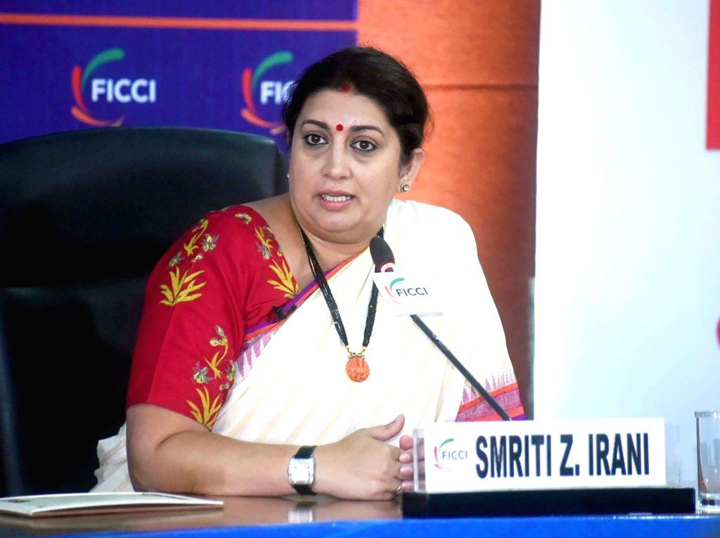New Delhi: Union Minister for Women & Child Development and Textiles Smriti Irani addresses at the Fireside Chat function, in New Delhi on Sep 13, 2019. (Photo: IANS/PIB) - Smriti Irani