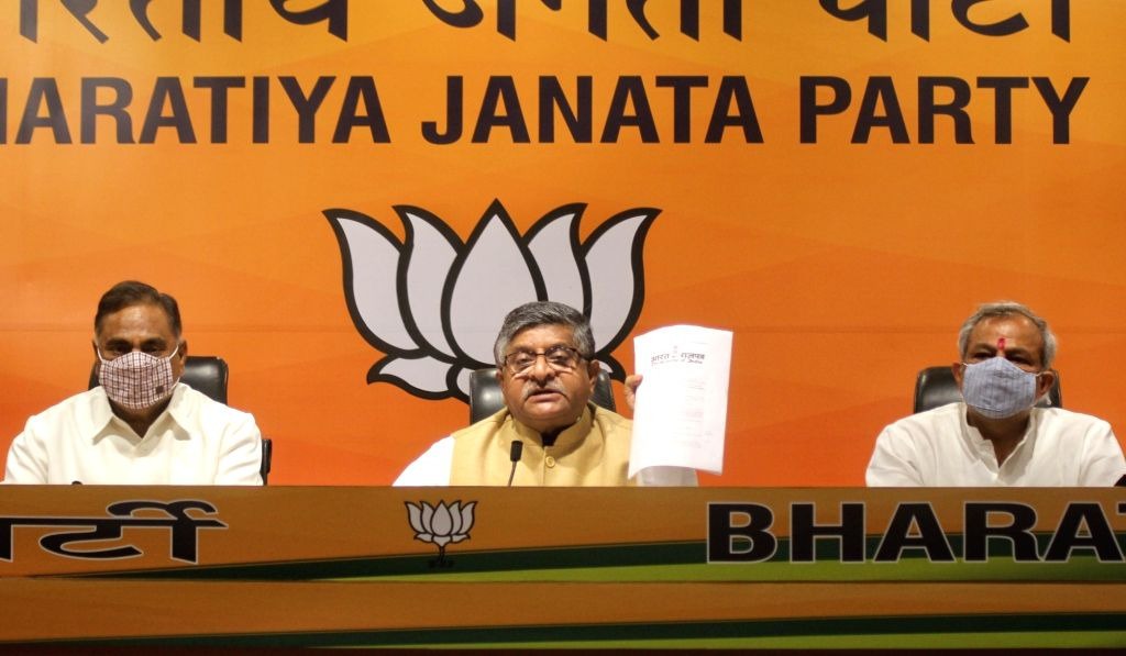 New Delhi :  Union Minister  Law and Justice, Electronics and Information Technology and Communications Ravi Shankar Prasad, Adesh Gupta, LoP Rambir Singh Bidhudi and others address a press ... - Law, Adesh Gupta and Rambir Singh Bidhudi