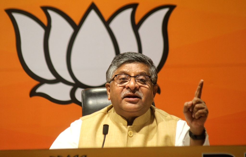 New Delhi :  Union Minister  Law and Justice, Electronics and Information Technology and Communications Ravi Shankar Prasad, Adesh Gupta, LoP Rambir Singh Bidhudi and others address a press conference at BJP HQ 6A, DDU Marg, in New Delhi on Friday 11 - Law, Adesh Gupta and Rambir Singh Bidhudi