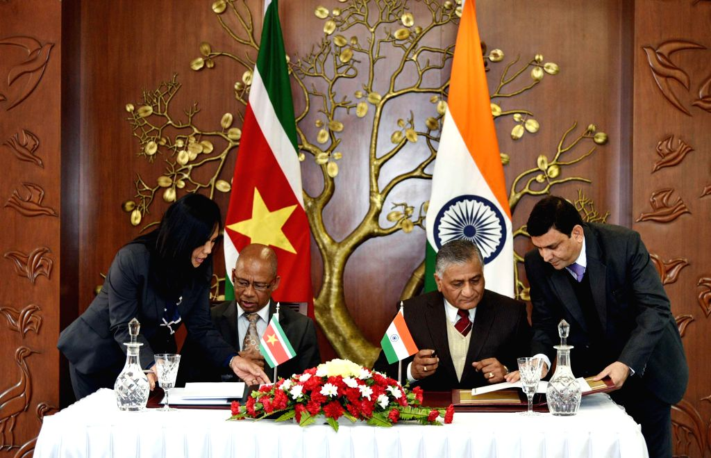 Union Minister of State for External Affairs General (Retd.) V.K. Singh and Suriname Foreign Affairs Minister Winston G. Lackin sign agreements during a signing ceremony in New Delhi, on .. - Winston G. Lackin