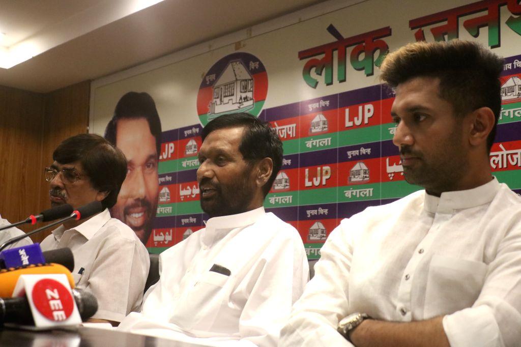New Delhi:Union MinisterRam Vilas Paswan accompanied by his son andLok Janshakti Party leaderChirag Paswan, addresses a press conference in New Delhi, on April 29, 2019. (Photo: IANS)