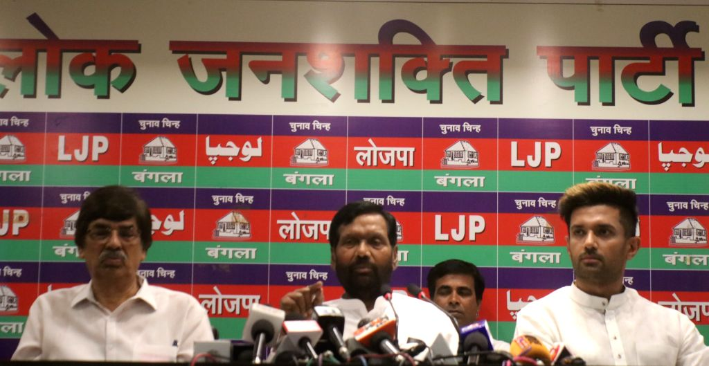New Delhi: Union Minister Ram Vilas Paswan accompanied by his son and Lok Janshakti Party leader Chirag Paswan, addresses a press conference in New Delhi, on April 29, 2019. (Photo: IANS) - Ram Vilas Paswan