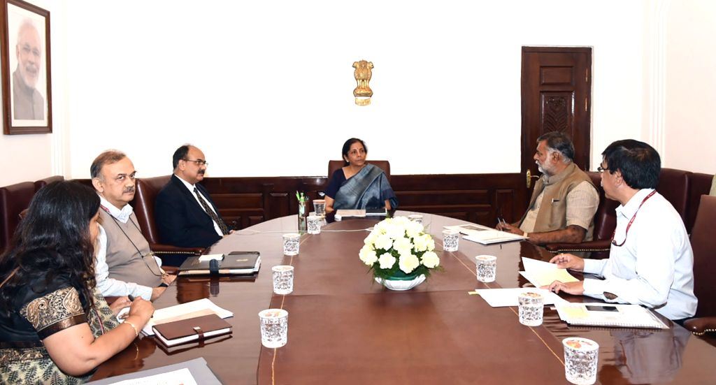 New Delhi: Union MoS Culture and Tourism Prahlad Singh Patel meets Union Finance and Corporate Affairs Minister Nirmala Sitharaman, to review the economic impact of 'COVID-19' on Tourism Sector, in New Delhi on March 20, 2020. (Photo: IANS/PIB) - Nirmala Sitharaman and Prahlad Singh Patel