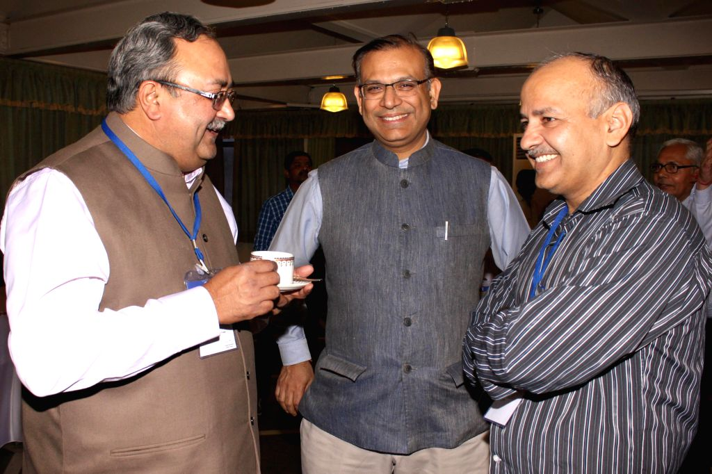 Union MoS Finance Jayant Sinha with Delhi Finance Minister Manish Sisodia and Gujarat Finance Minister Saurabhbhai Patel during a meeting with the Finance Ministers of States and the Union ... - Manish Sisodia, Jayant Sinha and Saurabhbhai Patel