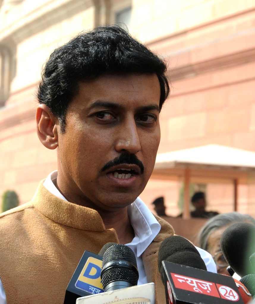 New Delhi : Union MoS for Information and Broadcasting Col. Rajyavardhan Singh Rathore addresses the press at the Parliament in New Delhi, on Nov 27, 2014. - Rajyavardhan Singh Rathore