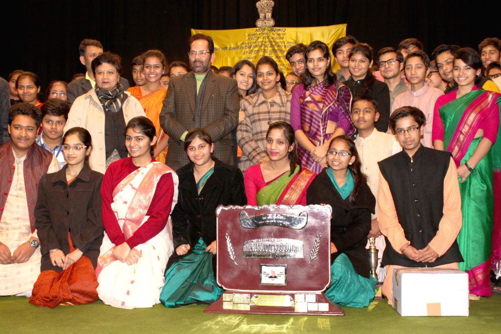 Union MoS for Parliamentary Affairs Mukhtar Abbas Naqvi with the students at the `49th Youth Parliament Competition, 2014-15` award function in New Delhi, on Dec 30, 2014.