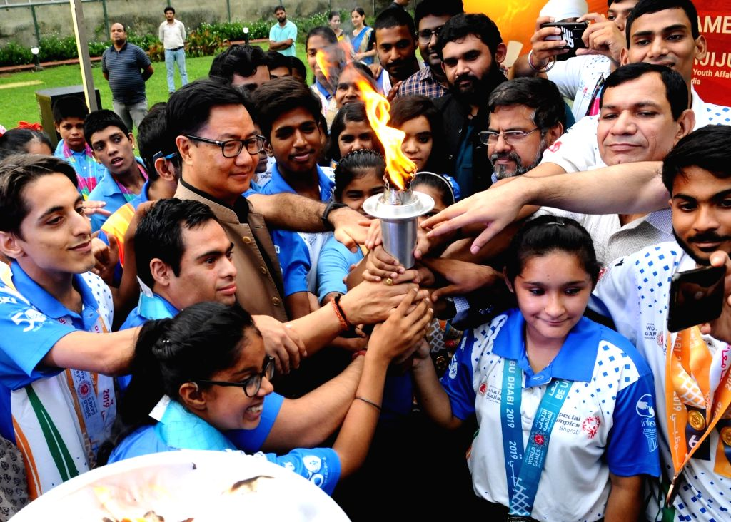 """New Delhi: Union MoS Sports and Yourth Affairs (I/C) Kiren Rijiju with the Special Olympics Torch, in New Delhi on July 26, 2019. The Special Olympics Torch """"Flame of Hope"""" reached New Delhi today after traveling from Singapore. (Photo: IANS)"""