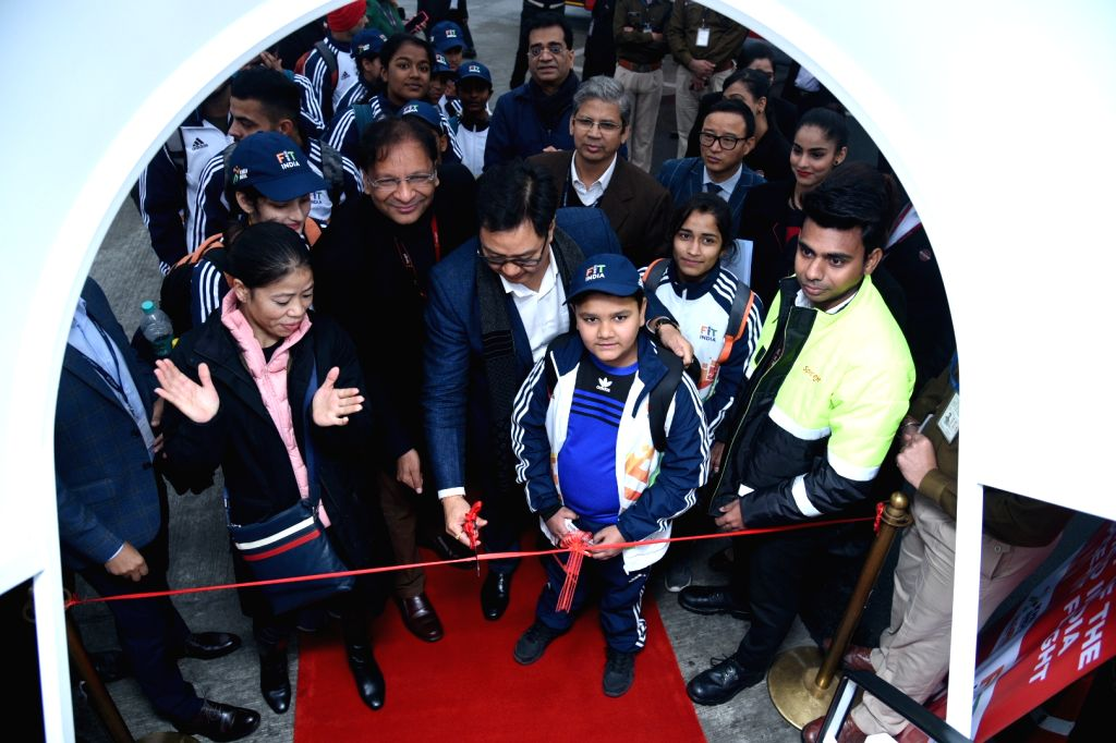 New Delhi: Union MoS Youth Affairs and Sports Kiren Rijiju accompanied by SpiceJet Chairman and MD Ajay Singh and boxer MC Mary Kom, inaugurates the first Khelo India SpiceJet flight during the sending of ceremony of the athletes leaving for Khelo In - Mary Kom and Ajay Singh