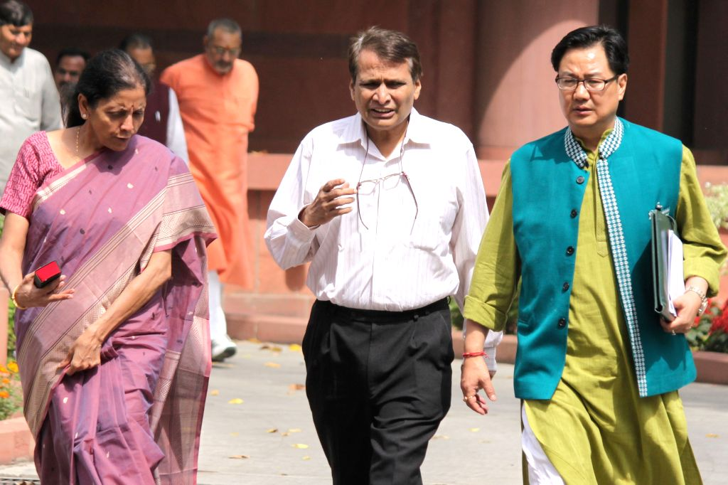 Union MoSs Nirmala Sitharaman and Kiren Rijiju with Union Railways Minister Suresh Prabhu at the Parliament in New Delhi, on April 21, 2015. - Suresh Prabhu