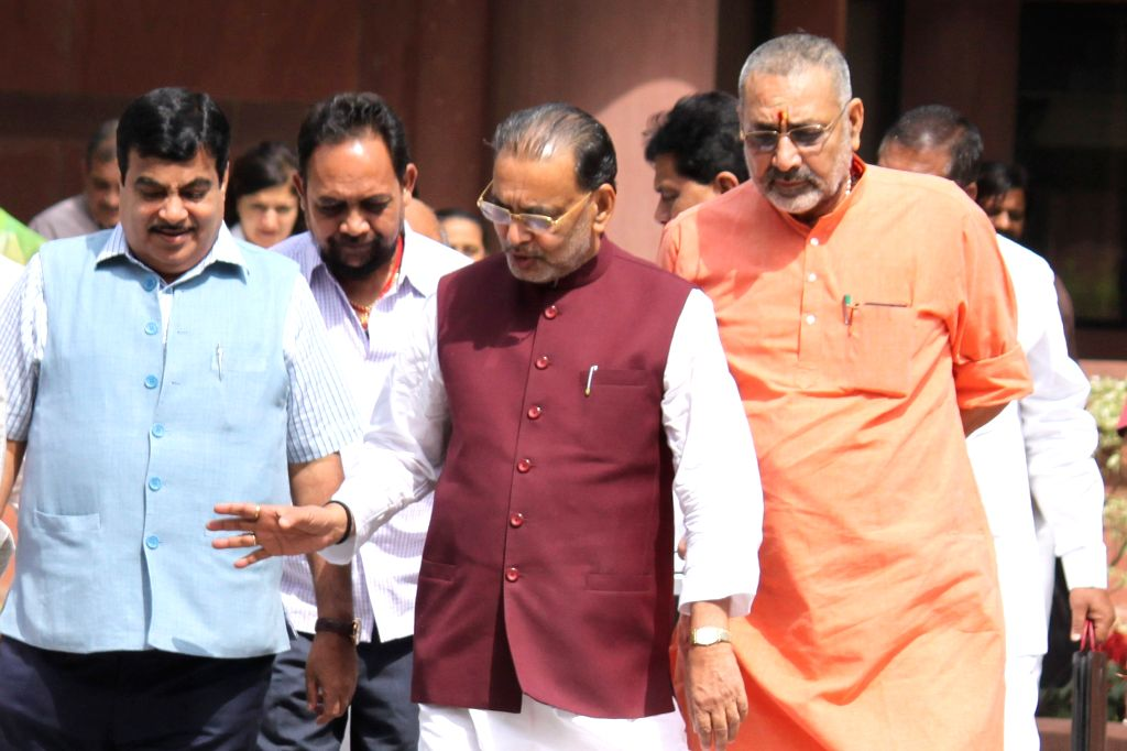 Union Road Transport, Highways and Shipping Minister Nitin Gadkari, Union Minister of State for MSME Giriraj Singh and Union Agriculture Minister Radha Mohan Singh at the Parliament house ...