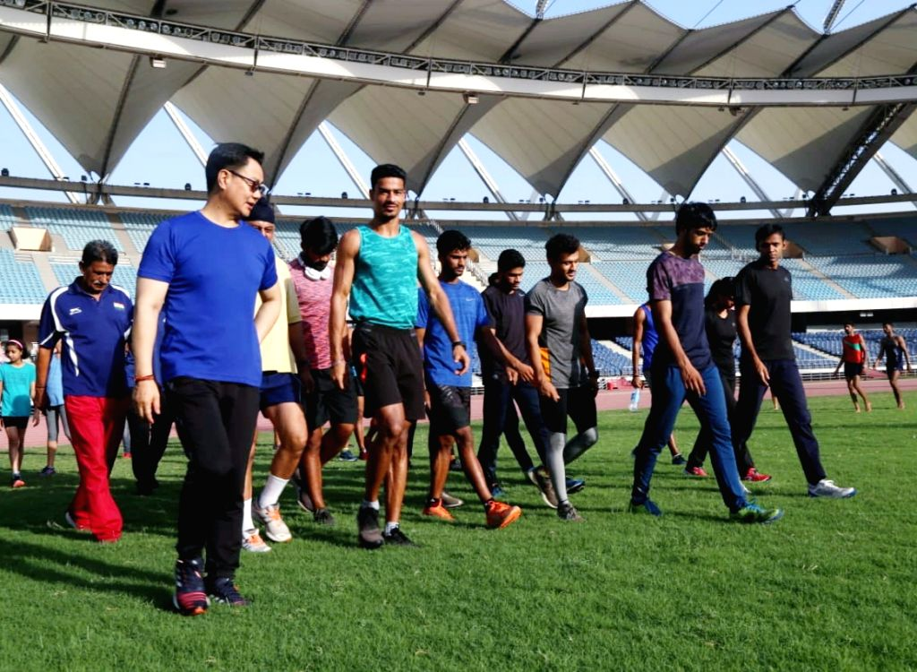 New Delhi: Union Sports Minister Kiren Rijiju meets athletes for morning exercise, breakfast at Jawaharlal Nehru Stadium in New Delhi on June 14, 2019. (Photo: IANS) - Kiren Rijiju
