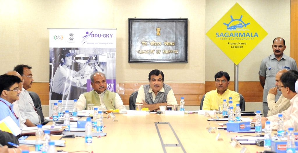 New Delhi: Union Transport Minister Nitin Gadkari addresses during a programme organised to sign an MoU between the Ministry of Shipping and the Ministry of Rural Development for Sagarmala ... - Nitin Gadkari and Narendra Singh Tomar