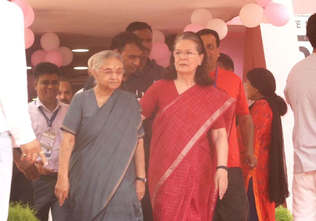 New Delhi: UPA chairperson Sonia Gandhi accompanied by Delhi Congress President Sheila Dikshit at Nirman Bhavan polling booth during the sixth phase of 2019 Lok Sabha elections, in New Delhi on May 12, 2019. (Photo: Bidesh Manna/IANS) - Sonia Gandhi and Sheila Dikshit