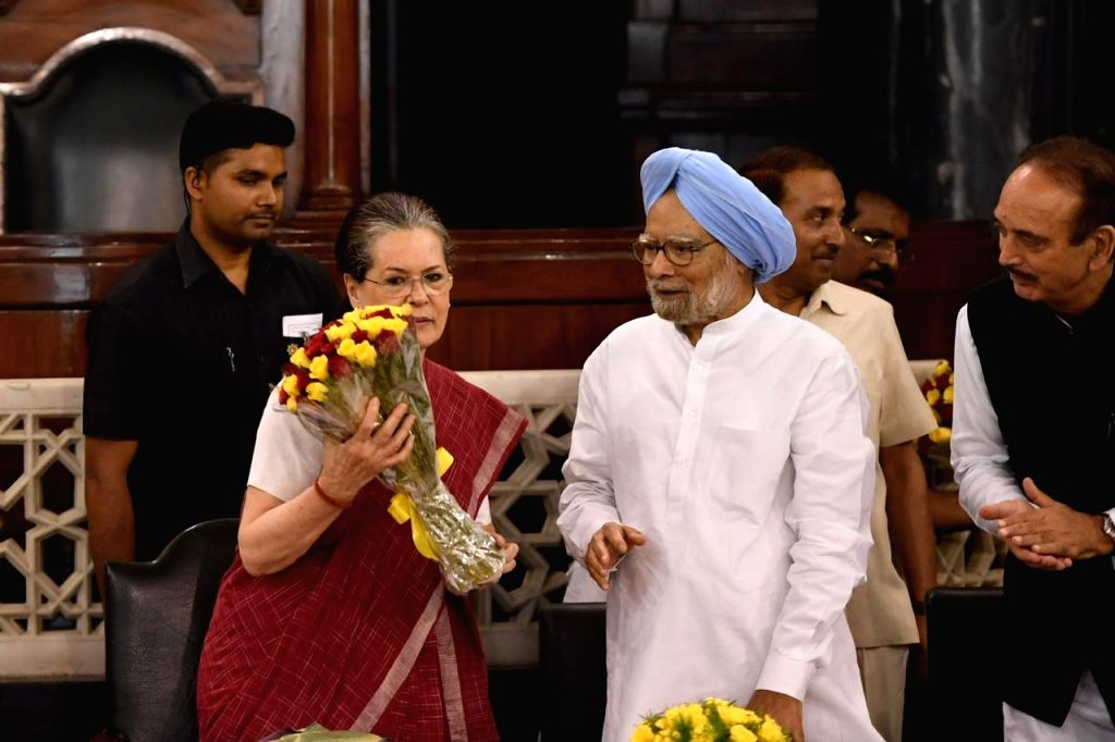 New Delhi: UPA chairperson Sonia Gandhi with Congress leaders Manmohan Singh and Ghulam Nabi Azad during the Congress Parliamentary Party (CPP) meeting in New Delhi on June 1, 2019. Sonia Gandhi will continue as the Congress Parliamentary Party leade - Sonia Gandhi and Manmohan Singh
