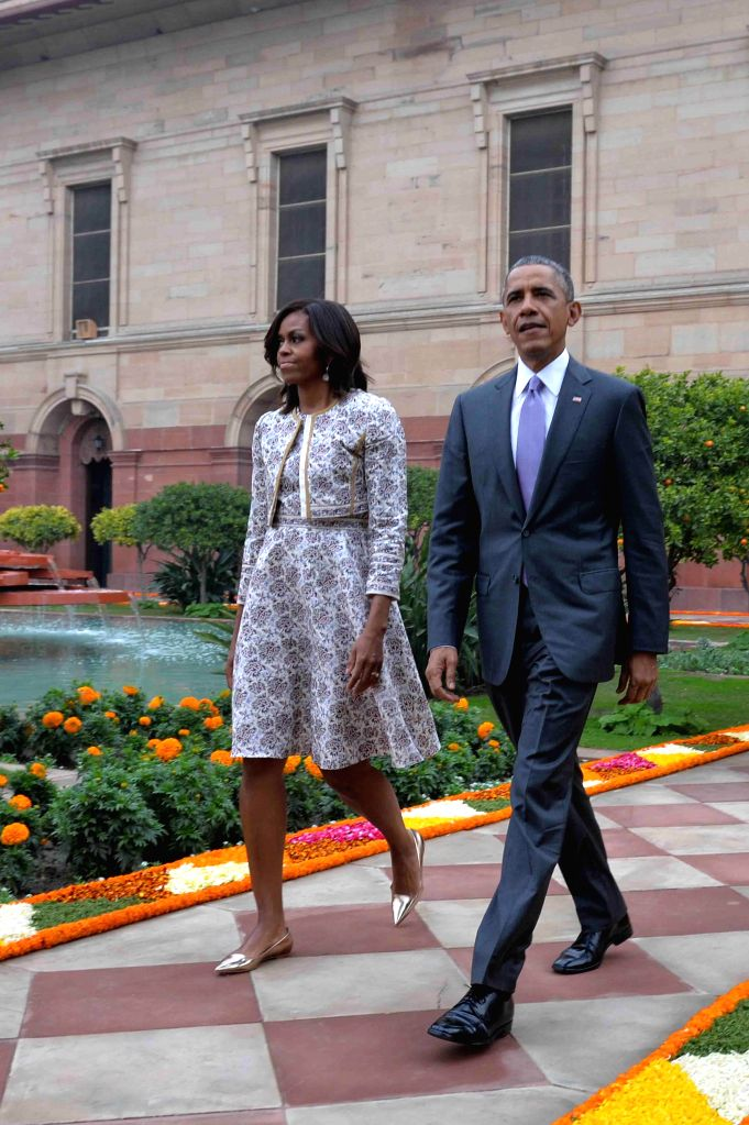 US President Barack Obama and First Lady Michelle Obama arrive to at the `At Home` function organised by President Pranab Mukherjee on Republic Day at Rashtrapati Bhawan in New Delhi, on .. - Pranab Mukherjee