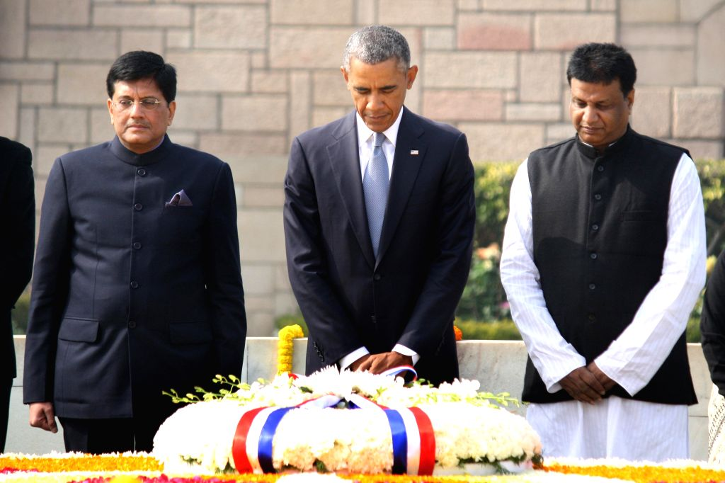 US President Barack Obama pays tribute to Mahatma Gandhi at  Raj Ghat -Gandhi's memorial, in New Delhi, on Jan 25, 2015. Also seen Union Minister of State (Independent Charge) for Power, ..