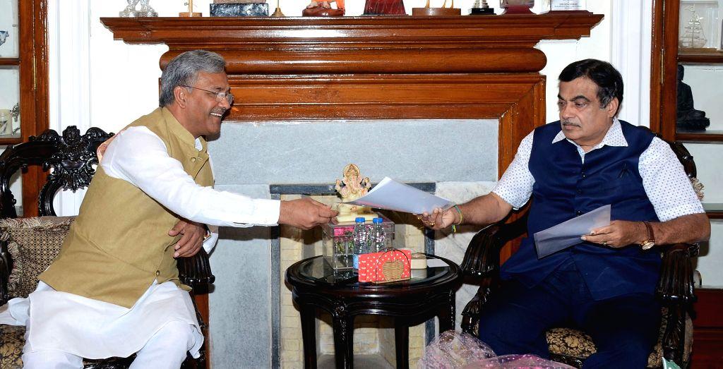 New Delhi: Uttarakhand Chief Minister Trivendra Singh Rawat meets Union Minister for Road Transport and Highways and Micro, Small and Medium Enterprises Nitin Gadkari, in New Delhi on June 15, 2019. (Photo: IANS/PIB) - Trivendra Singh Rawat