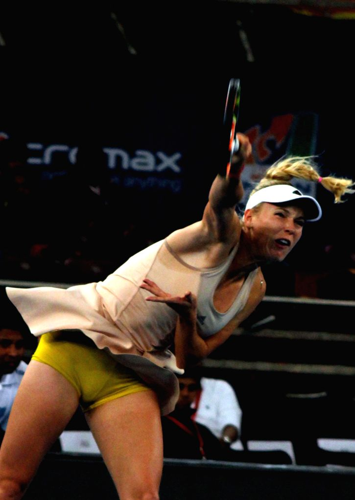 UUAE Royals Caroline Wozniacki in action during her women's singles match Singapore Slammers Daniela Hantuchova on the Coca-Cola International Premier Tennis League (IPTL) at IG Indoor ..
