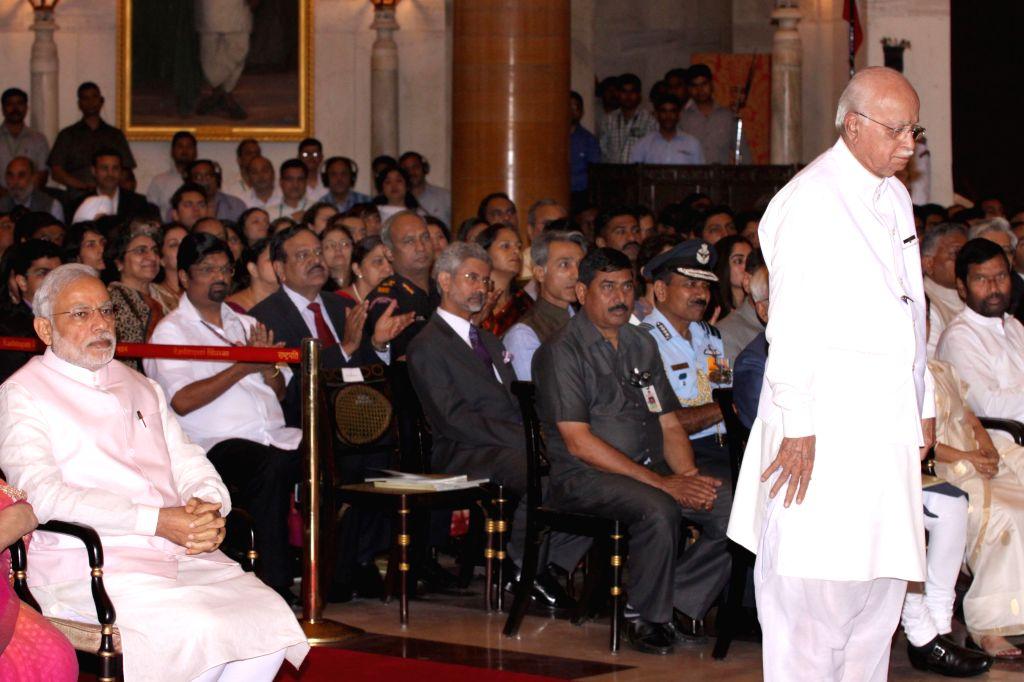 Veteran politician and parliamentarian L K Advani during a Civil Investiture Ceremony where he was conferred the Padma Vibhushan Award  by President Pranab Mukherjee in New Delhi on March ... - Narendra Modi, L K Advani and Pranab Mukherjee