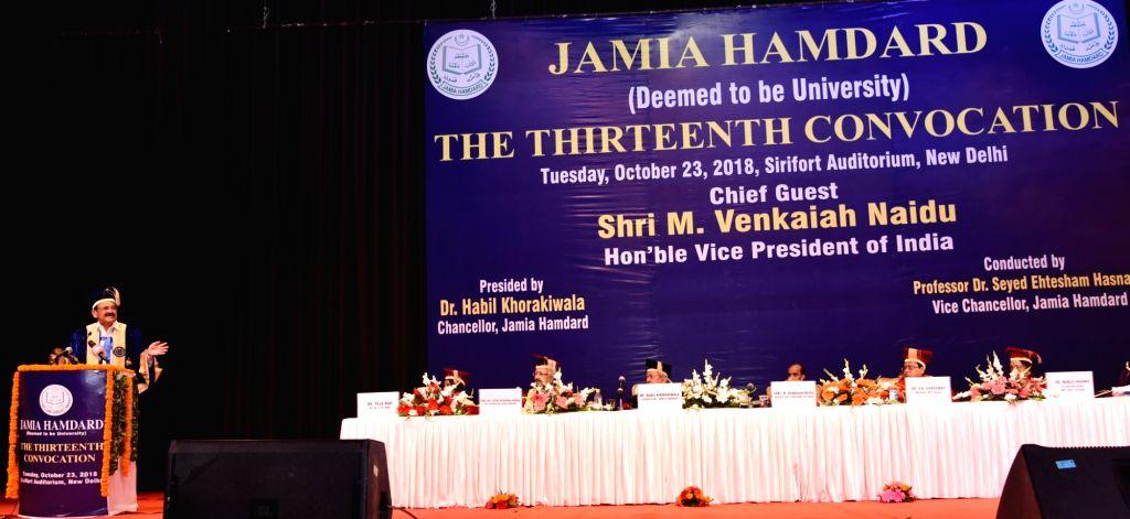 :New Delhi: Vice President M. Venkaiah Naidu addresses at the 13th convocation of Jamia Hamdard University in New Delhi on Oct 23, 2018. (Photo: IANS/PIB).