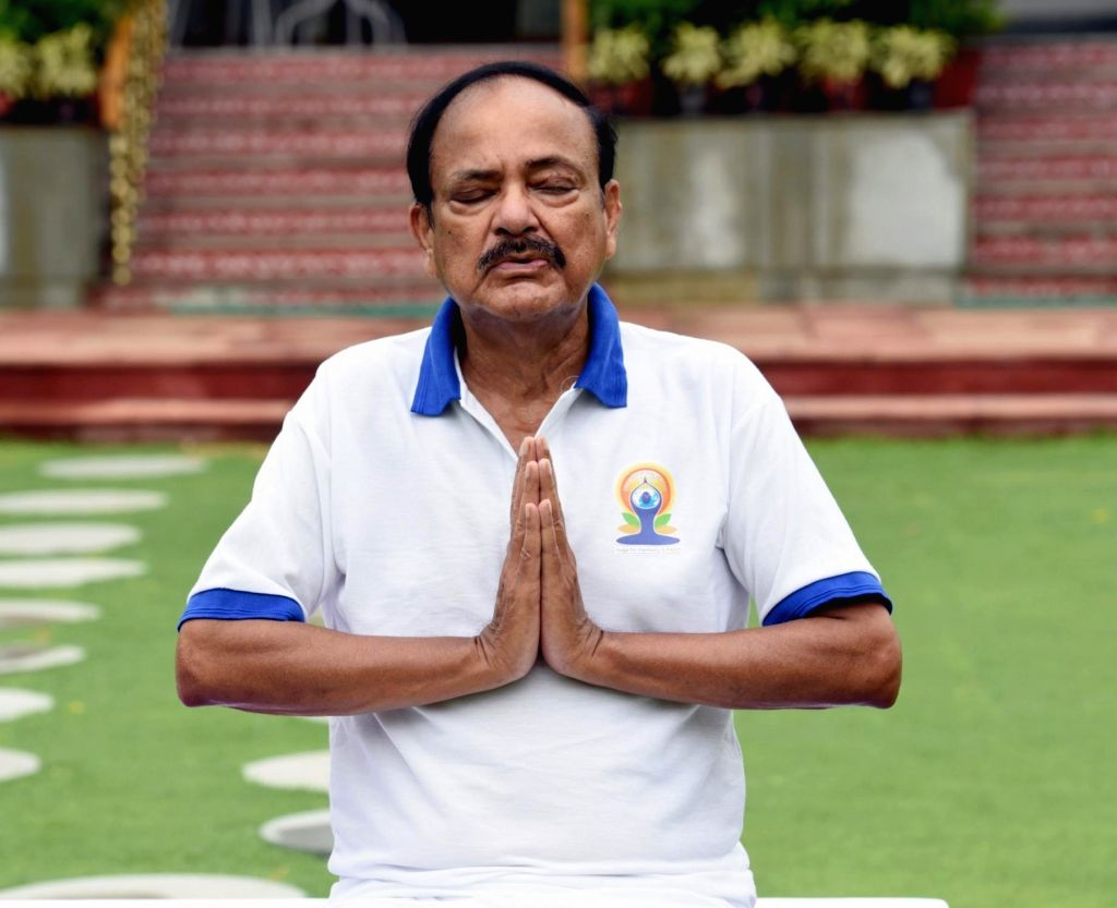 New Delhi: Vice President M Venkaiah Naidu practices yoga asanas - postures - on the occasion of 6th International Yoga Day in New Delhi on June 21, 2020. (Photo: IANS/PIB) - M Venkaiah Naidu