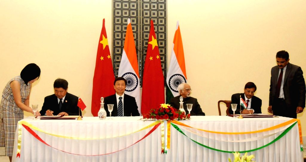 : New Delhi: Vice President Mohd. Hamid Ansari and the Vice President of the People`s Republic of China, Li Yuanchao witness the signing ceremony, in New Delhi on Nov. 6, 2015. (Photo: IANS/PIB).