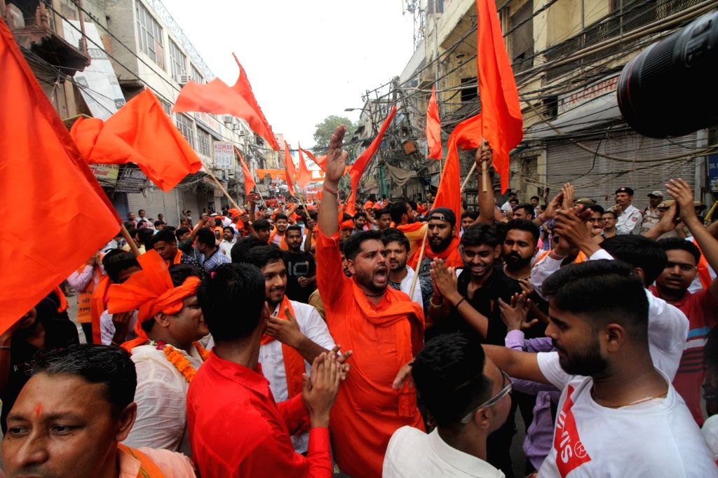 New Delhi: Vishwa Hindu Parishad (VHP) activists participate in a 'Shobha Yatra' in Delhi's Hauz Qazi area, on July 9, 2019. (Photo: IANS)