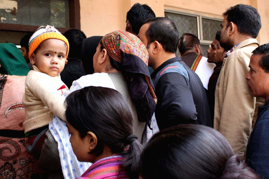 Voters at a polling booth during Delhi Assembly Polls in New Delhi, on Feb 7, 2015.