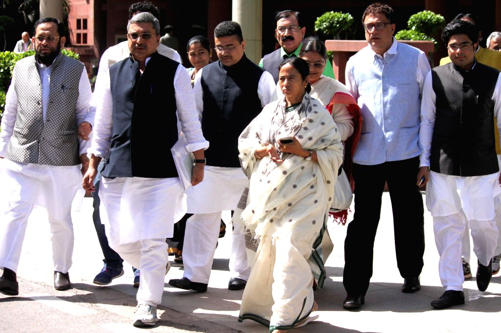 West Bengal Chief Minister Mamata Banerjee with Trinamool Congress MPs after meeting Prime Minister Narendra Modi at the Parliament in New Delhi, on March 9, 2015. - Narendra Modi