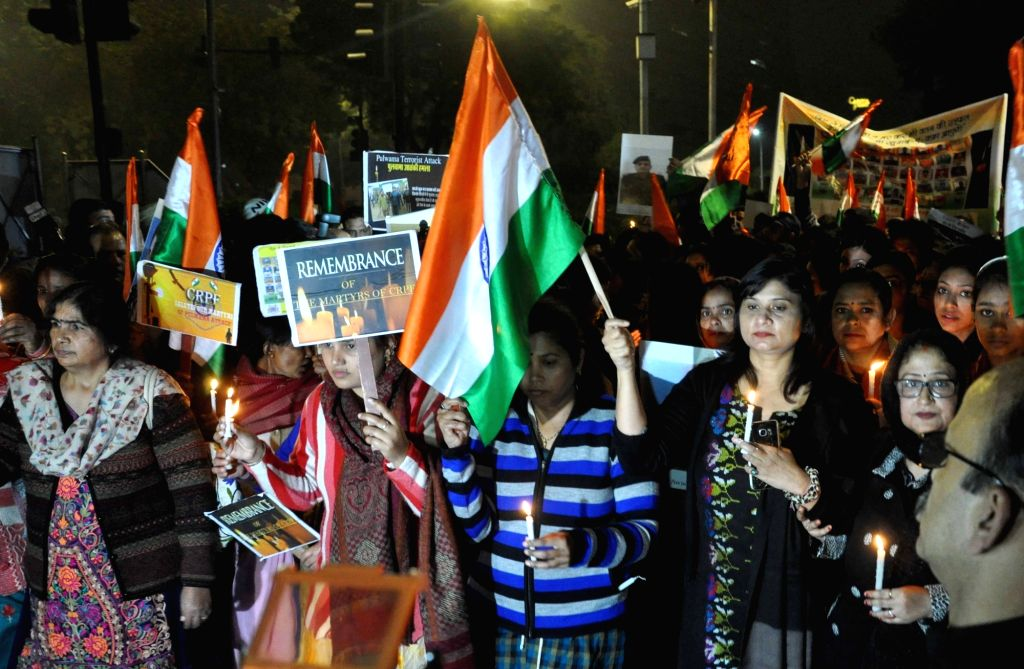 New Delhi: Wives of CRPF personnel participate in a candle light vigil to protest against 14 Feb Pulwama militant attack in which 49 CRPF men were killed; in New Delhi on Feb 16, 2019. (Photo: IANS)