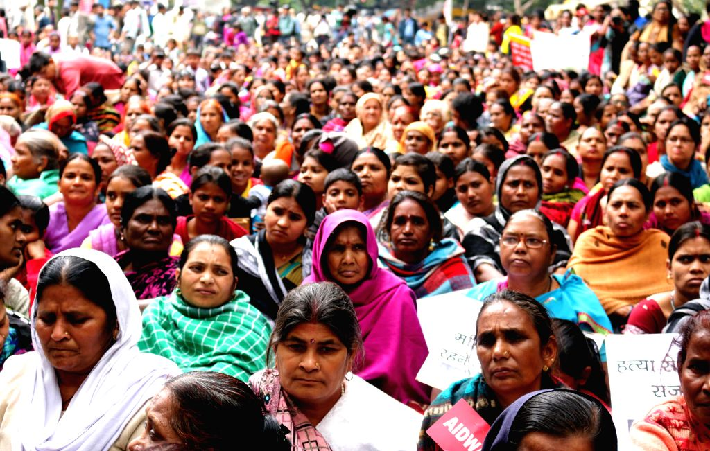 Women participate in a programme organised to observe International Women`s Day at Jantar Mantar in New Delhi, on March 8, 2015.