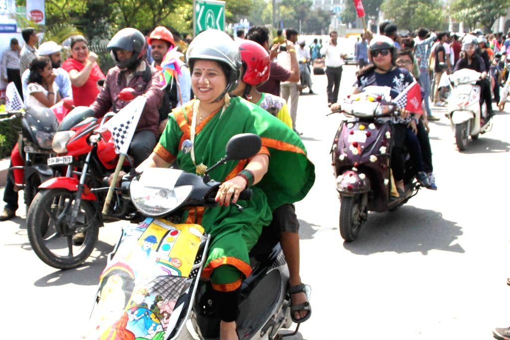 New Delhi: Women participate in an All Woman Bike Rally in New Delhi, on March 13, 2016. (Photo: Amlan Paliwal/IANS)
